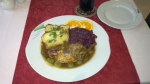 Grey Partridge stuffed with roe deer, red cabbage, and Thüringer Aschklöße